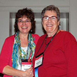 """Receiving my blue """"debut author"""" ribbon from Leslie Budewitz, national president of Sisters in Crime"""