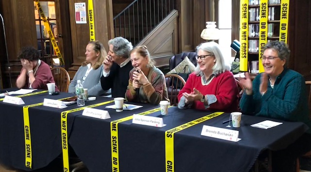 "Lynne Raimondo (face in hands, at far left) did her best to herd the cats on this panel, titled ""A Woman's Place is on the Page . . . And Writing It."" We are, from left, Beth Ineson, Jim Ziskin, Dorothy Cannell, Julia Spencer-Fleming and me."